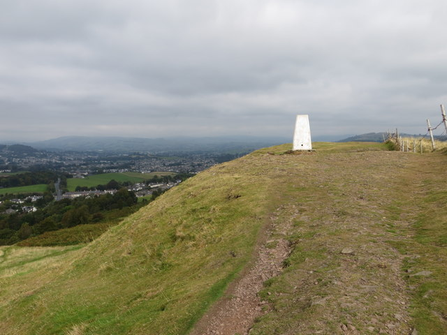 The Helm and its Triangulation Pillar with Oxenholme and Kendal in the background