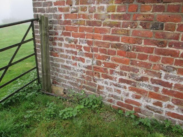 O/S  Bench  Mark  on  outbuilding  at  Northfield  Farm