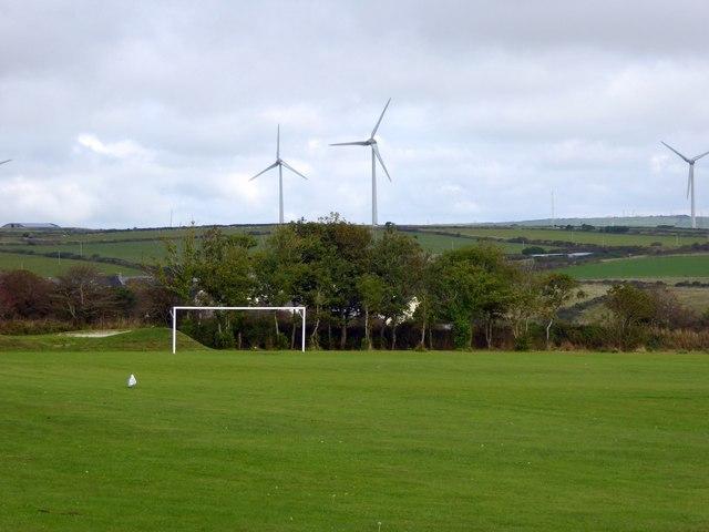 Delabole football ground and distant wind-turbines