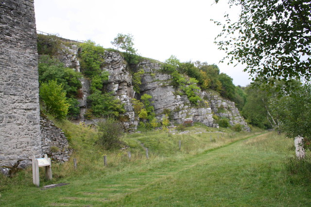 Disused quarry next to lime kilns beside dismantled railway