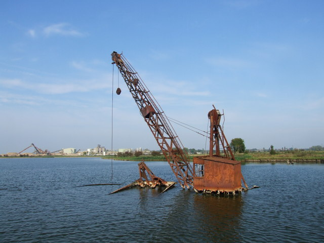 Crane rusting in a flooded gravel pit, near Cliffe