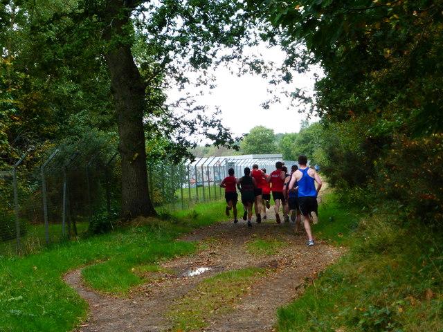 Runners on bridleway approach barracks