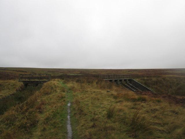 Footbridge and spillway at Spa Clough