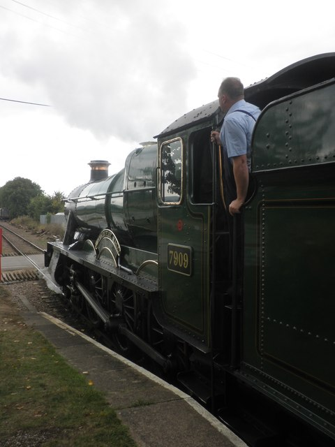 7909 Heveningham Hall, leaves Dunster with a train for Minehead
