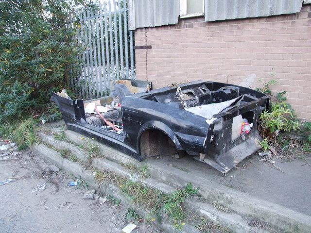 Remains of a car, Wharf Road, Denton