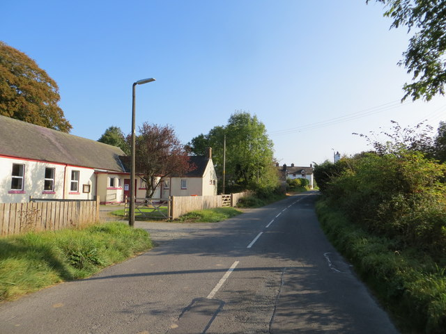 Road (B7068) and Village Hall at Bankshill