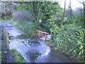 SM8934 : Flooded road near Tregwynt Woollen Mill by Martyn Harries