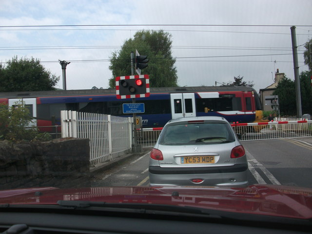 Cononley Level Crossing with train