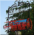 TM3569 : Peasenhall village sign (detail) by Adrian S Pye