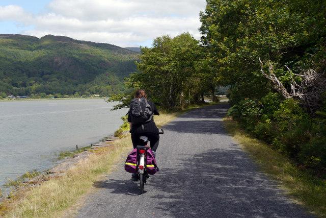 Cycling on the Mawddach Trail alongside Coed-y-garth