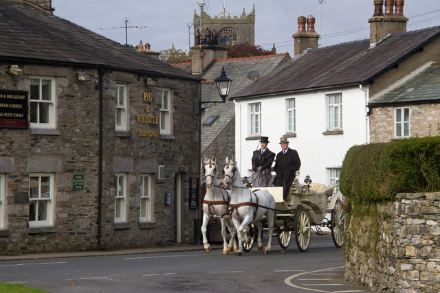 The bridal carriage passes the Pig and Whistle