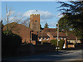 Looking across Squires Bridge Road towards the junction of Magdalene Road with the church of St Mary Magdalene in the background.
