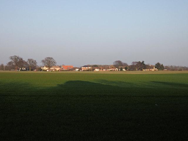 Grimston Lane across farmland