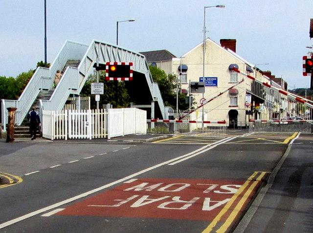 Level crossing barriers descend across the B4304, Llanelli