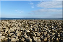 NU1441 : Stones at Castle Point by DS Pugh