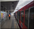 Platform 3 at Canning Town DLR station with an eastbound train ready to depart.