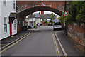 Looking through the railway bridge to the post office and Swan Inn.