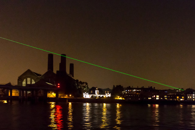 Greenwich meridian laser beam over the river seen from the Thames