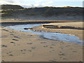 NZ4936 : Stream and Hart Warren Dunes by Oliver Dixon