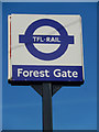 A TFL Rail sign has replaced the National Rail symbol outside Forest Gate station, although the latter is still just visible around the edge. TFL Rail is the temporary name used for Liverpool Street - Shenfield services until they are taken over as part of Crossrail.