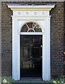 A fine mid-Georgian doorcase with a variety of enriched mouldings and simple radial fanlight.
