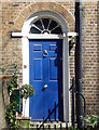 Simple Georgian doorcase with a decorative fanlight.