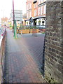 Dist:0.1km<br/>Looking past the north west corner of Shotton railway bridge in Chester Road West. There is an Ordnance Survey bench mark on the corner of the bridge - [[4813329]], and the narrow pavement opens out in front of The Central Hotel.