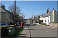 TL4452 : Hauxton High Street in early spring by John Sutton