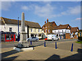 TL1439 : War memorial and buildings on High Street, Shefford by Robin Webster