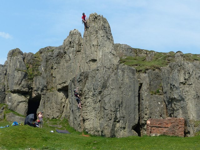 Cave and climbers, Harborough Rocks