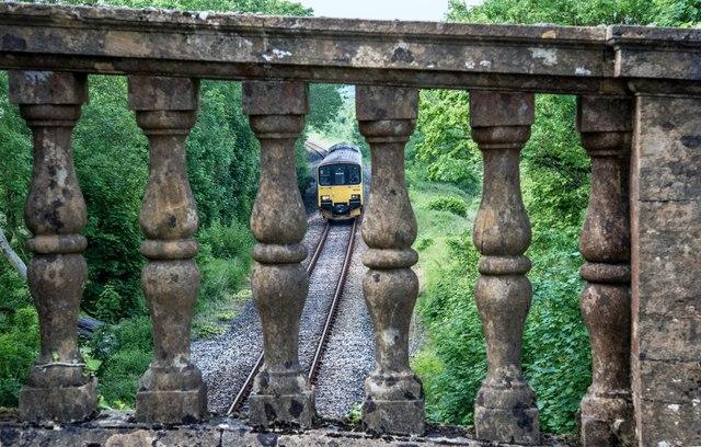 Chantmarle: Train going under road bridge