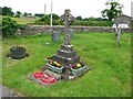 SJ0502 : War memorial, Llanllugan churchyard by Christine Johnstone
