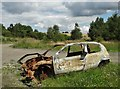 SE4302 : Burnt out car wreck near Bolton Ings by Neil Theasby