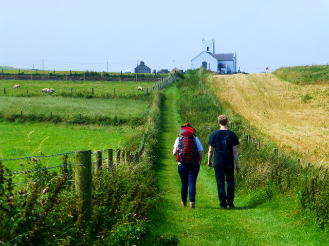 Walkers along the coastal path, Ballintoy