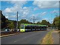 TQ3663 : Tram leaving Addington Village by Malc McDonald