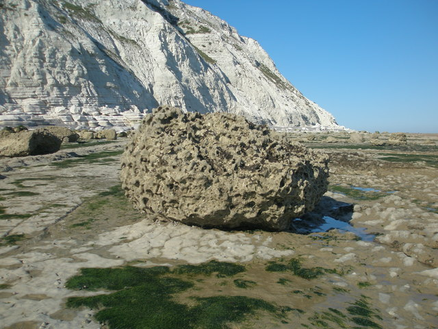 Eroded chalk boulder perched on the wave-cut platform at Beachy Head