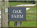 TL9167 : Oak Farm sign by Adrian Cable