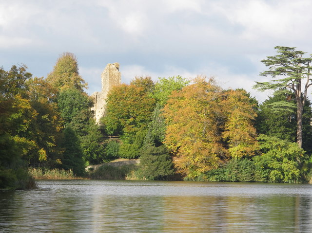 Old Sherborne Castle and autumn trees seen across lake