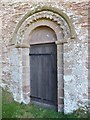 SO5659 : Norman arch and door, Pudleston church by Philip Halling