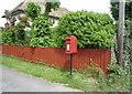 TL6458 : Elizabeth II postbox on High Street, Stetchworth by JThomas