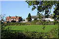 SJ6353 : Pasture and housing at Acton near Nantwich, Cheshire by Roger  Kidd