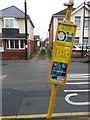 SZ1392 : West Southbourne: footpath H11 and a leaning bus stop sign by Chris Downer