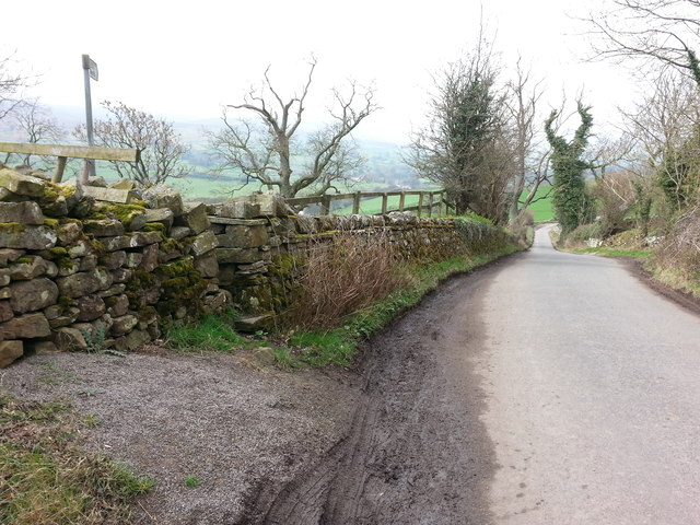 Road on Burfitts Bank with Footpath and stile in dry stone wall