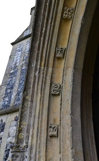 Gissing, St. Mary's Church: Flowers alternating with crowns on the c1474 north porch