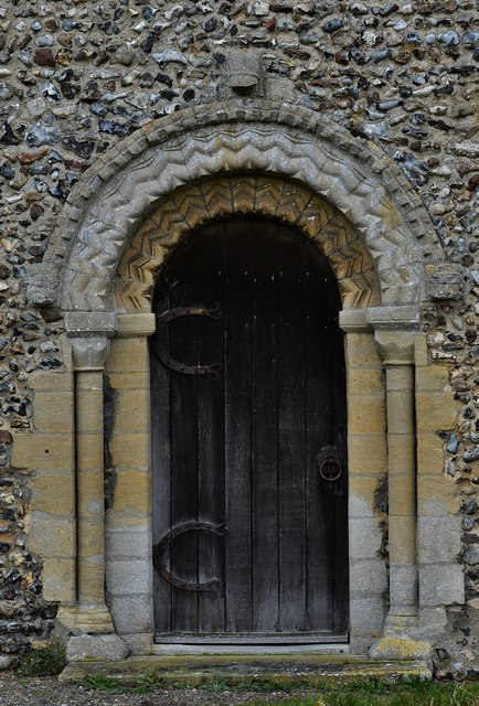 Gissing, St. Mary's Church: Norman south doorway with zigzag moulding 1