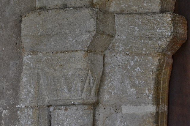 Gissing, St. Mary's Church: Norman north doorway capital 1