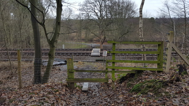 Stile on footpath that crosses Carlisle railway at Farnley Banks