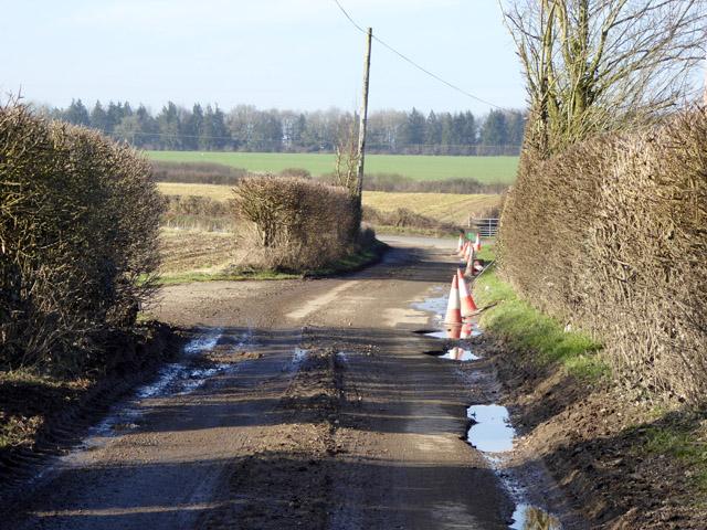 Badly pot-holed lane