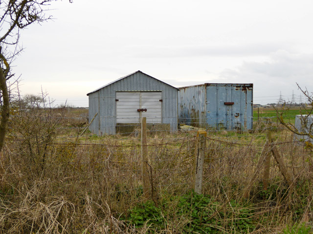 A shed and a container by Dungeness Road