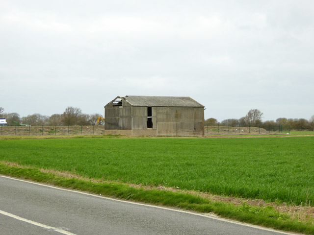 Damaged asbestos barn